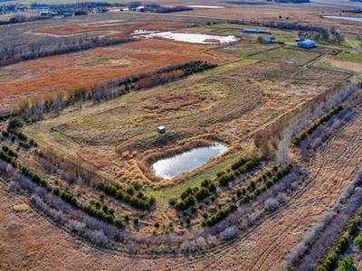 98 ACRES OF LAND WITH A CUSTOM HOUSE FOR SALE IN ORANGEVILLE