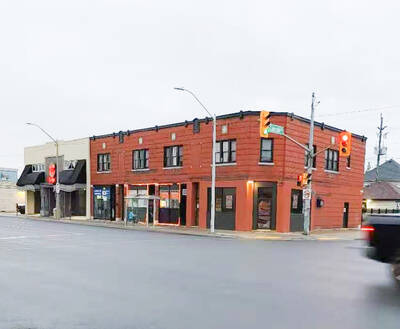 6000 sqft 4 commercial units and 4 residential 2 bedroom units building on major road